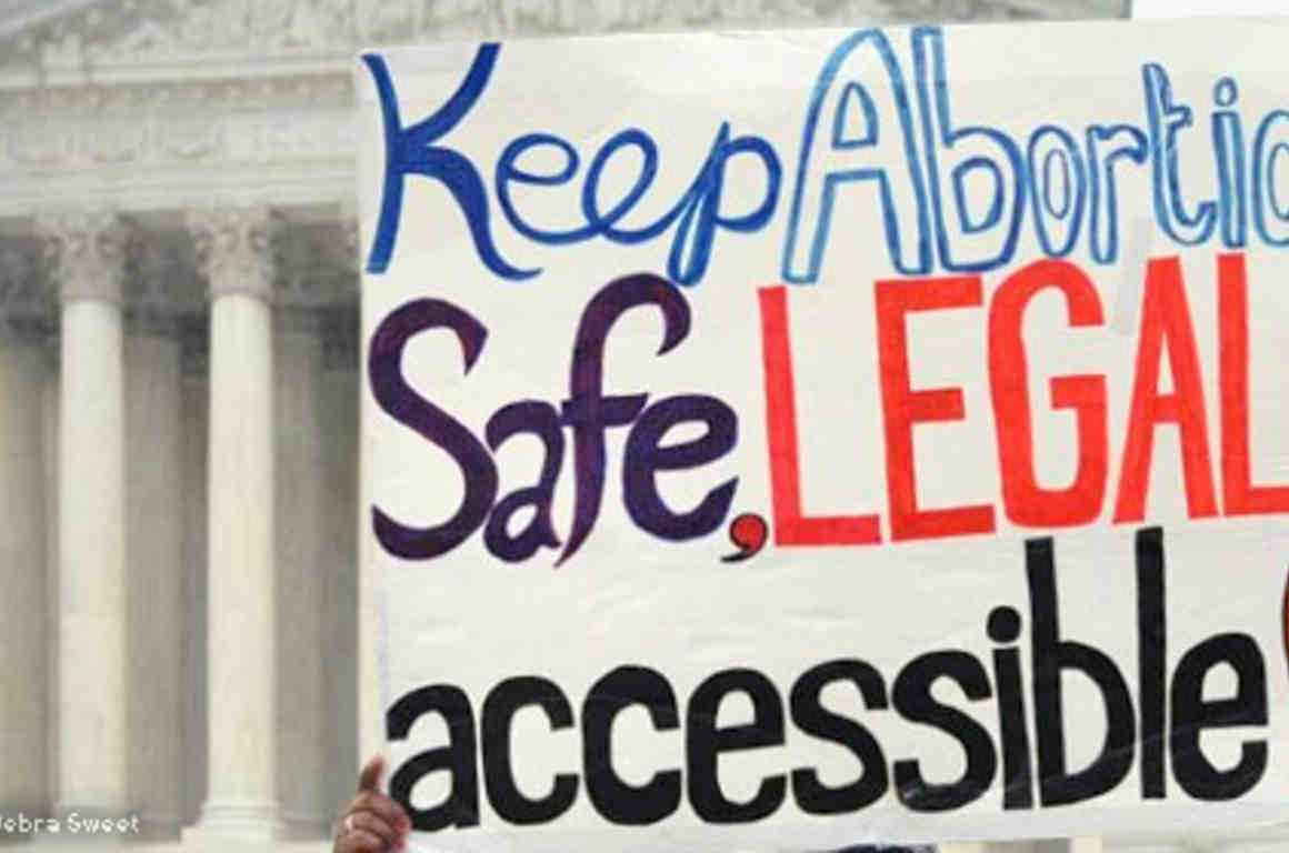"Protest sign reading ""Keep abortion safe, legal and accessible"""