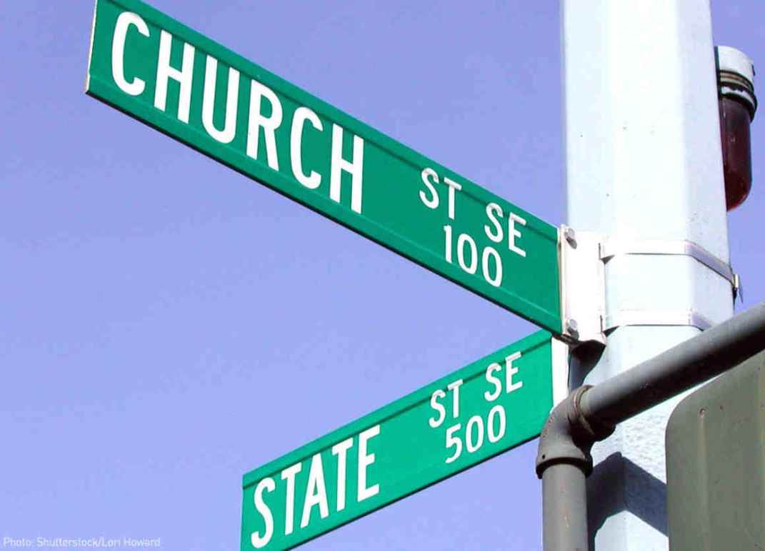 Street signs showing the corner of CHURCH and STATE