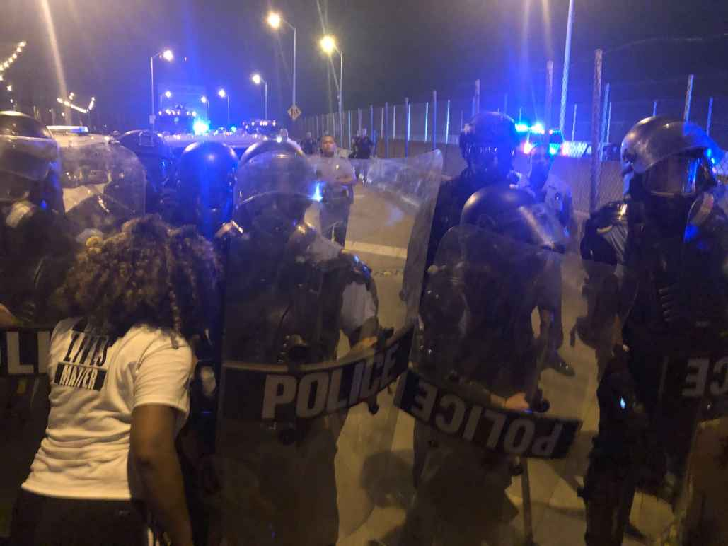Protesters and police clashing at the CCC bridge in New Orleans