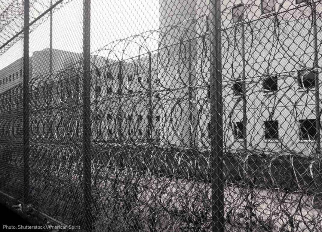Razor wire and fence outside jail