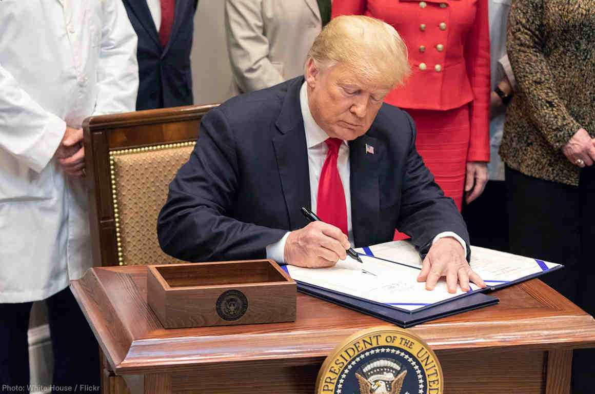 President Donald Trump signing an executive order