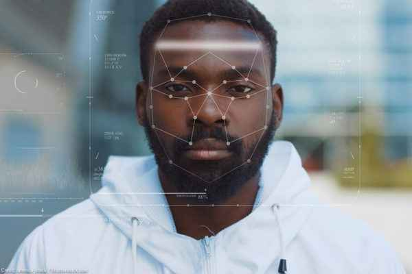 A black man being targeted with facial recognition technology