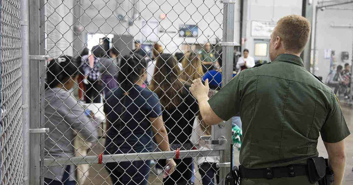 Image of immigrants in a detention facility